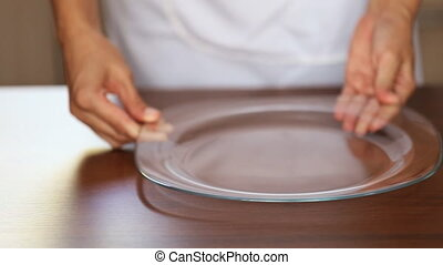 chef puts a glass plate
