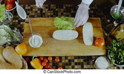 Chef Puts Salad Leaf On A Sandwich. . Restaurant Business