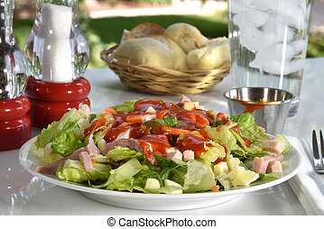 Chef salad on a picnic table