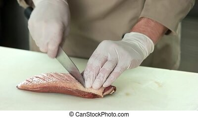 Chef scoring duck breast. Raw poultry meat.