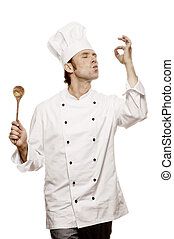 """Chef doing a gesture of """"buongusto"""", isolated on white"""