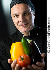 Chef showing fresh vegetables