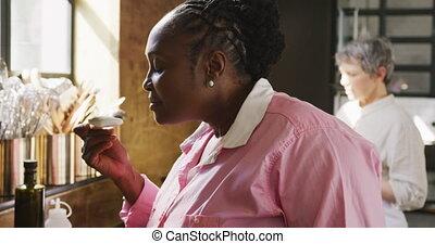 Chef smelling a cream - Side view close up of a senior ...