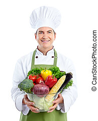 Chef - Smiling chef with vegetables. Isolated over white...