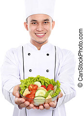 chef smiling with salad