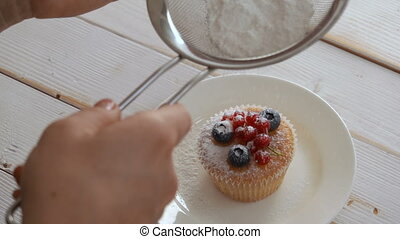 chef sprinkled with powdered sugar cupcake decorated with...