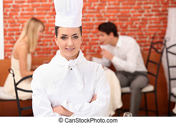 Chef stood in front of couple dining