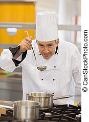 Chef tasting his soup