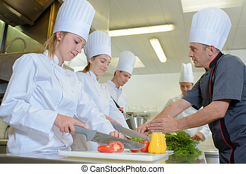Chef teaching students on catering course