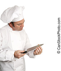 Chef Tests Blade - A male chef testing the sharpness of his...