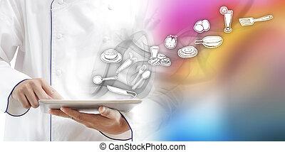 Chef using digital tablet
