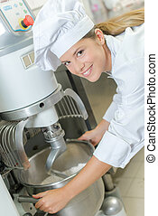 Chef using industrial mixer