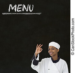 Chef with chalk menu sign on a blackboard background - Chef ...