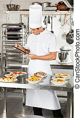 Chef With Clipboard Checking Pasta Dishes
