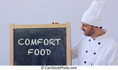 Chef with Comfort Food sign - Comfort Food sign with chef in...