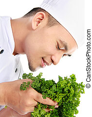 chef with fresh ingredient - Professional chef smelling ...