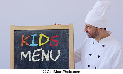 Chef with KIDS MENU sign - KIDS MENU sign with chef in...