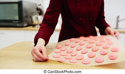 chef with macaron batter at confectionery