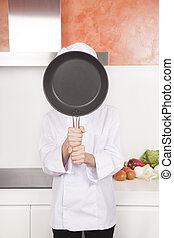 chef with pan on face