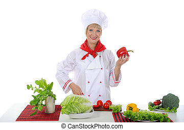 Chef with red pepper in her hand.