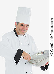 Chef with whisk and bowl