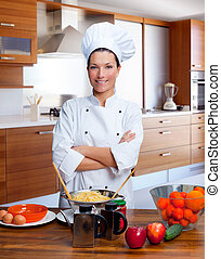 Chef woman portrait in the kitchen