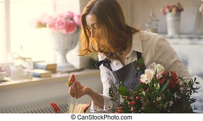 Chef woman preparing flowers, fruits and vegetables for...