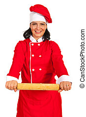 Chef woman showing rolling pin