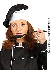 Chef woman taste soup