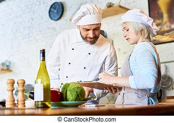 Chef Working in Cafe Kitchen