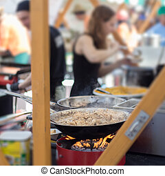 Cheff cooking on outdoor street food festival. - Cheff...