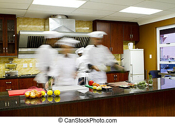 chefs cooking in kitchen - group of chefs cooking in...