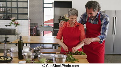 Chefs enjoying cooking together - Front view of a senior ...