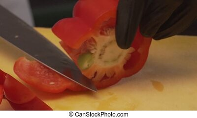 Chef's Hand Cuts Off The Core Of Red Bell Pepper