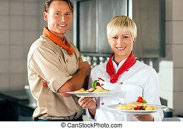 Chefs in a restaurant or hotel kitchen