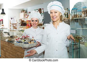 Chefs meeting customers at door