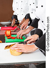 chefs preparing food - professional chefs preparing food in...