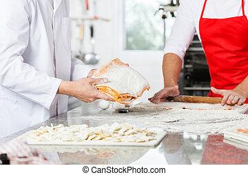 Chefs Preparing Ravioli Pasta At Kitchen Counter