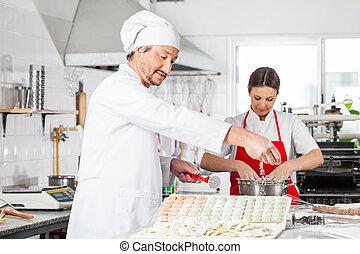 Chefs Preparing Ravioli Pasta