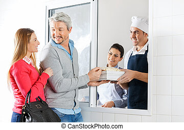 Chefs Selling Pasta Packets To Couple Through Window