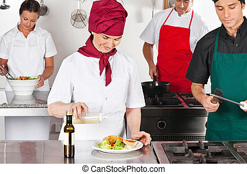 Chefs Working In Kitchen