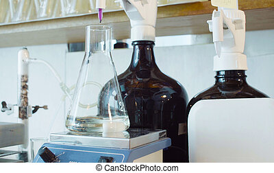 Chemical analysis laboratory. Flask with solution during titrating