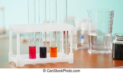 chemical experiments, laboratory test tubes with reagents....