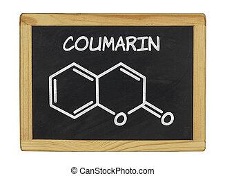 chemical formula of coumarin on a blackboard