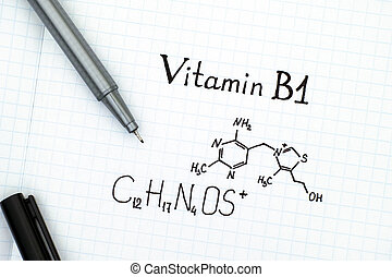 Chemical formula of Vitamin B1 with black pen. Close-up.