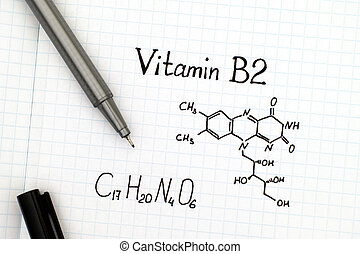 Chemical formula of Vitamin B2 with pen.
