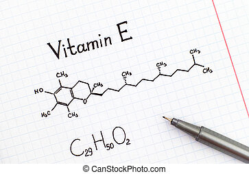 Chemical formula of Vitamin E with pen