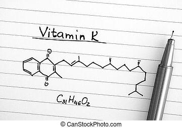 Chemical formula of Vitamin K with black pen.