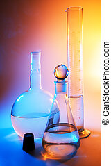 chemical glassware in multicolored lights