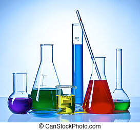 Chemical glasswares with colored liquids inside bottles